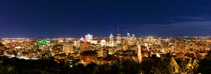 Montreal at night, view from Belvedere with amazing autumn colorful leaves. Beautiful panorama of Montreal downtown skyline in the fall night time.