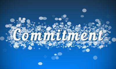 Commitment - white text written on blue bokeh effect background