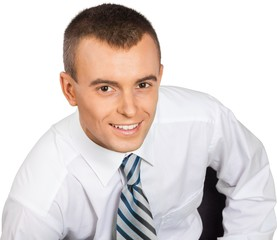 Young Businessman Sitting on Chair Close-Up - Isolated