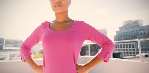 Serious looking woman standing confident for breast cancer
