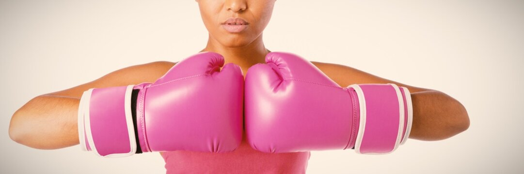 Woman for breast cancer awareness in boxing gloves