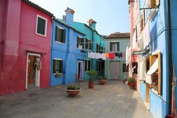 clothes on a courtyard between the houses of Burano