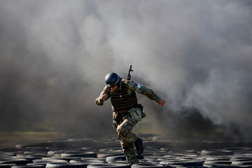 A National Guard serviceman takes part in a competition for entry to the elite units of the Guard at a base near Kiev