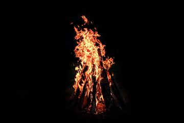 crest of flame on burning wood in fireplace