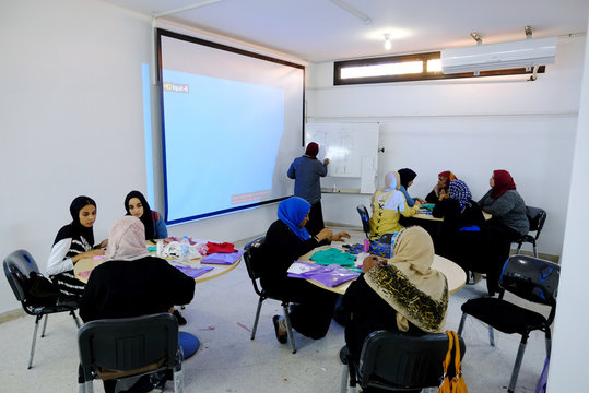 Women conduct training on sewing in a sewing workshop supervised by a charitable association to help widows, divorcees and needy in Benghazi