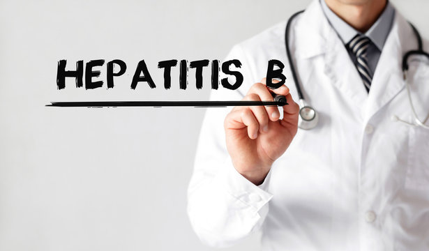 Doctor writing word Hepatitis b with marker, Medical concept