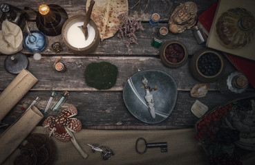 Magic potion preparation on the table of magician. Witchcraft or druidism concept background. Wall mural