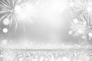 Fototapete - Silver and white Fireworks and bokeh in New Year eve and copy space. Abstract background holiday.