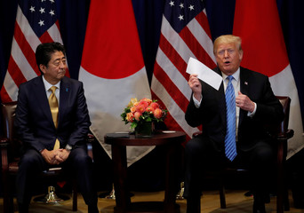 U.S. President Trump shows letter from North Korean leader Kim during bilateral meeting with Japan's Prime Minister Abe on sidelines of 73rd session of the United Nations General Assembly in New York
