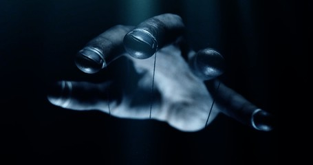 Puppet hands from leadership controlling our lives. Concept