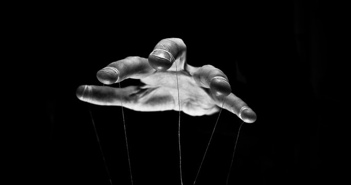 Eerie puppeteer hands controlling you. Manipulation concept