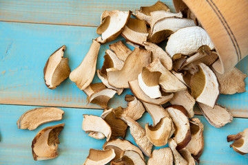dried mushrooms on old wooden blue background
