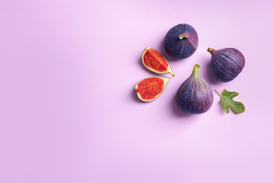 Fresh ripe figs on light background, top view. Space for text