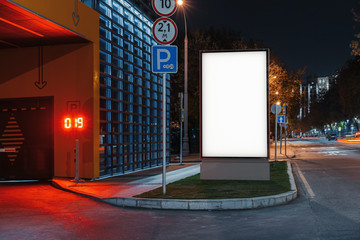 Blank white outdoor banner stand at night time in the city, 3d rendering.