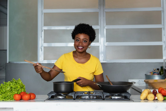 African american woman  enjoys cooking healthy food