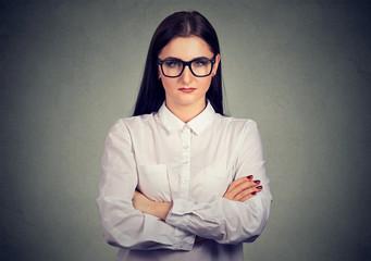 Serious grumpy woman in glasses