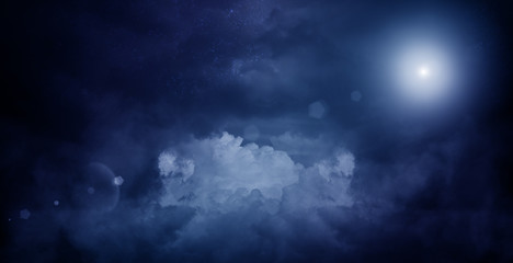 Abstract dark background of a night sky with clouds, a glow of the moon. The background of the storm sky
