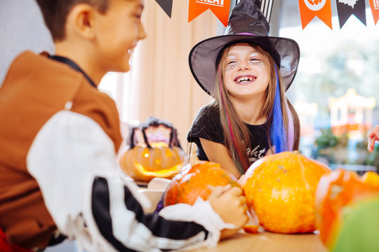 Laughing girl. Beautiful funny girl wearing wizard Halloween costume laughing out loud while playing games