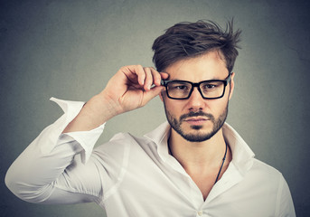 Confident man wearing trendy eyeglasses