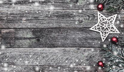 Wooden background. Merry Christmas inscription, text space, fir branches and gifts. Top view. Elements, balls and winter gifts. Snow effect