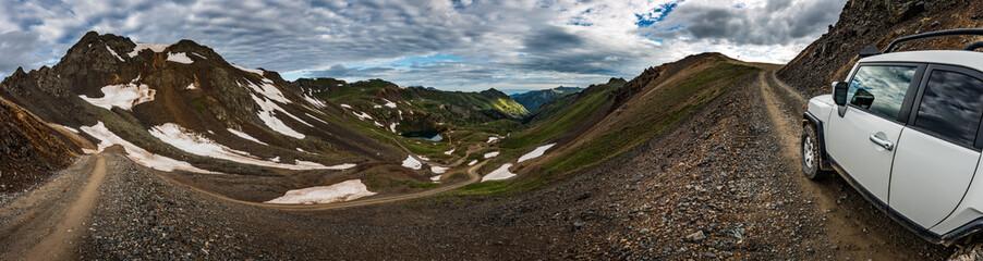 Off road Vehicle climbing up the California Pass San Juan Mountains Colorado Beautiful Panoramic Shot
