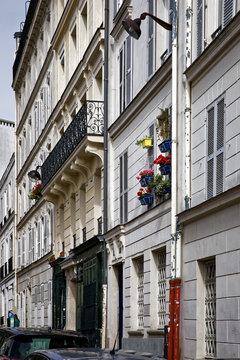 Paris, France - September 22, 2018: Typical buildings in famous neightbourhood Montmartre in Paris