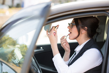 Young business woman portrait in her car