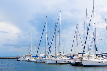 sailboats are moored on a pier