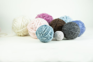 Multihued knitting wool balls.