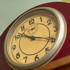 dial with arrows of old mechanical clock, close-up