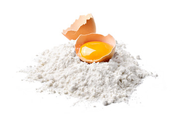 Chicken egg and flour on white background