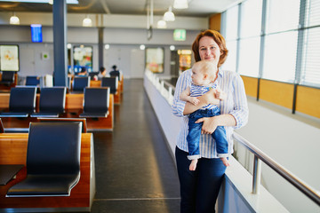 Woman with little girl in international airport