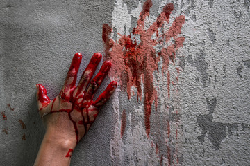 Bloody hand print on wall, crime and horror concept. Wall mural
