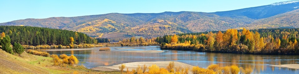 Panoramic view of the Irkut River on a September sunny day. Bright Autumn Landscape