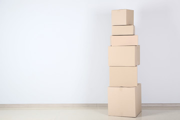 Cardboard boxes on grey background