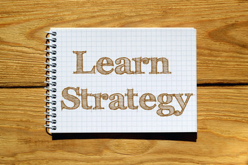 Composite image of digital image Of Learn strategy text