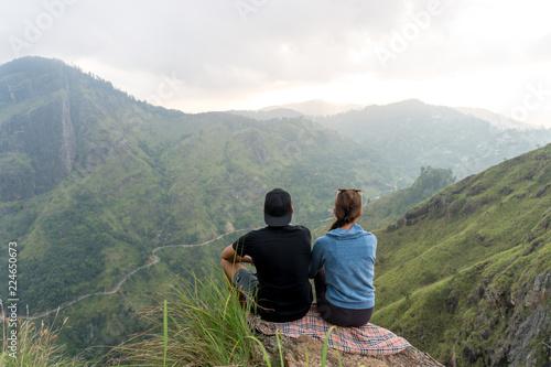 d783b586e1d6 Travel concept. Couple sitting on top of Small Adams peak near Ella ...