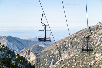 Chair lift up mountain with scenic California view