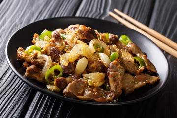 Asian food: spicy chicken stomachs with jalapeno pepper, onion, garlic and sesame close-up. horizontal