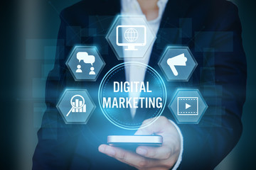 Businessman holding icon of Digital marketing technology concept,Creative design for banner..