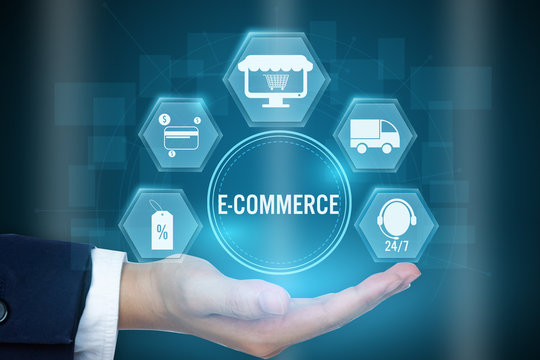 Businessman holding icon of E-commerce concept ,Creative design for banner..
