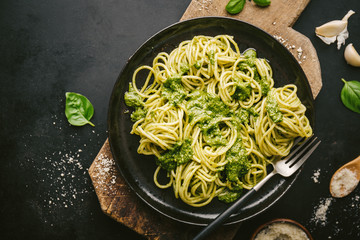 Tasty pasta with pesto served on plate