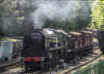 "Rebuilt Battle of Britain Class No 34053 "" Sir Keith Park "" at Alresford on the Mid Hants Railway."