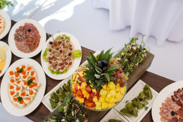 Snacks on served banquet table