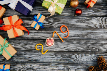 top view of 2019 symbol and christmas presents on wooden surface