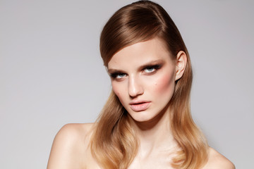 Smoky eyes. Young teenager fashion model with make up and blonde hair.