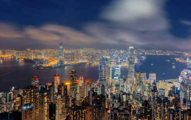 Aerial view of Hong Kong Downtown and Victoria Harbour. Financial district and business centers in smart city, technology concept. skyscraper and high-rise buildings at night.