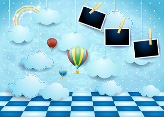 Surreal landscape with clouds, floor, balloons and photo frames