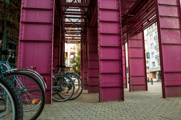 Pink metallic design near the library in Warsaw. Cityscape background