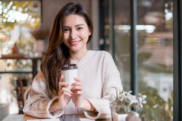 beautiful asian woman enjoy hot drink morninig time near window in cafe shop lifestyle ideas concept